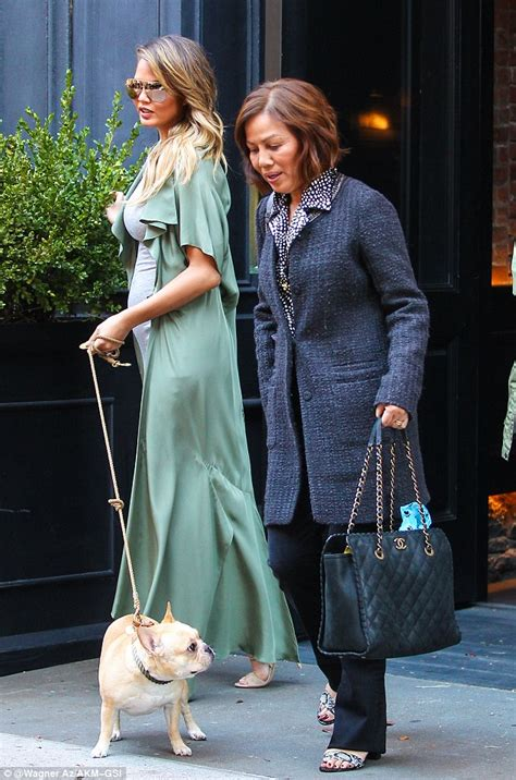 Pregnant Chrissy Teigen shows off growing baby bump in a